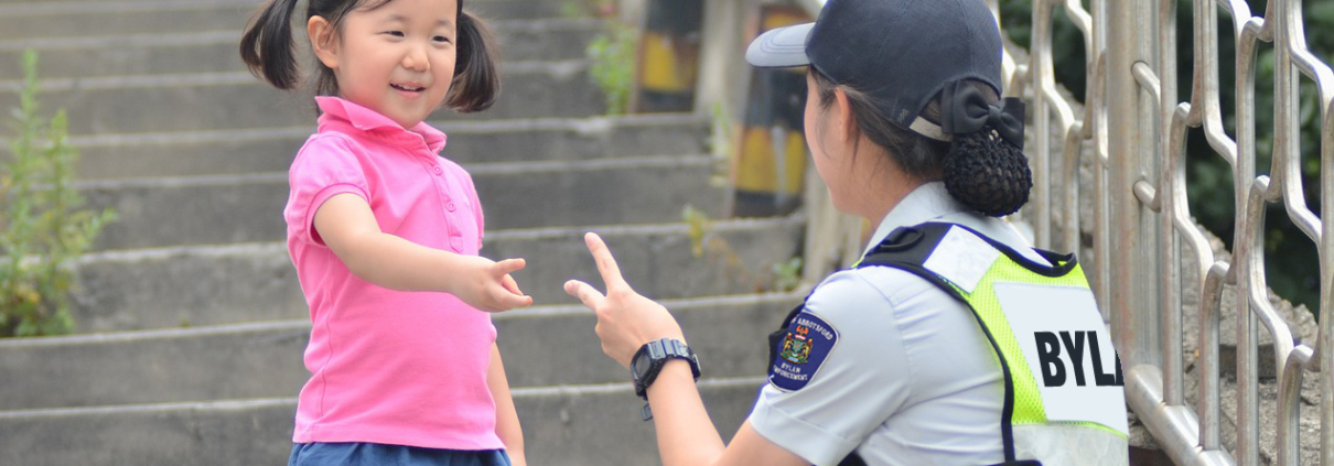 """Bylaw Officer playing """"Rock, Paper, Scissors""""."""